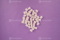 Sugar cubes on purple background stock photo