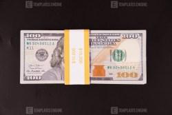 Ten Thousand dollars on black plastic background