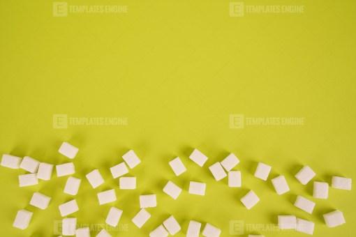 White sugar on bright green background