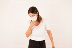 Woman cough with protective face mask
