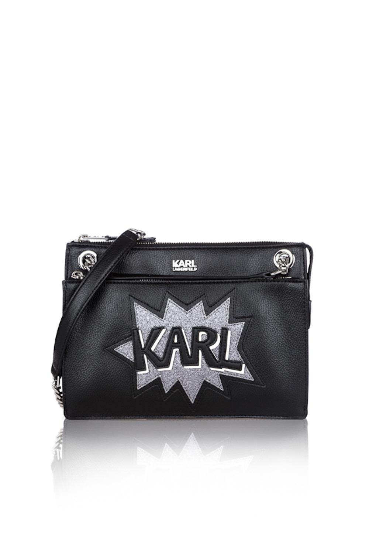 Packshot produit d'un sac à man en cuir noir sur fond blanc