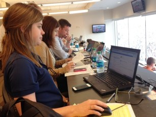 Abby, Katy, and Doug hard at work in the press box.