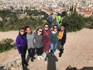 Another group photo, this time with the view FROM the Acropolis!