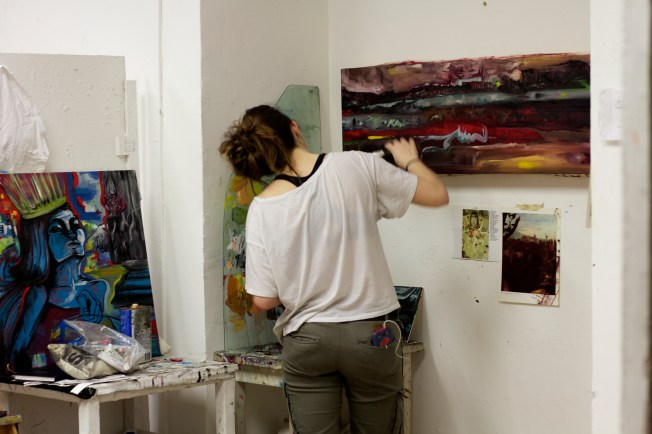 Art student working on a painting
