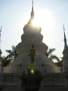 A Buddhist statue and stupa, located at a monastery in Jinghong, Xishuangbanna
