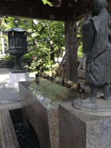 Special area meant for washing hands before entering the temple to meet god. Located along one of the trails on Mt. Takao in Hachiōji, Tokyo, Japan.