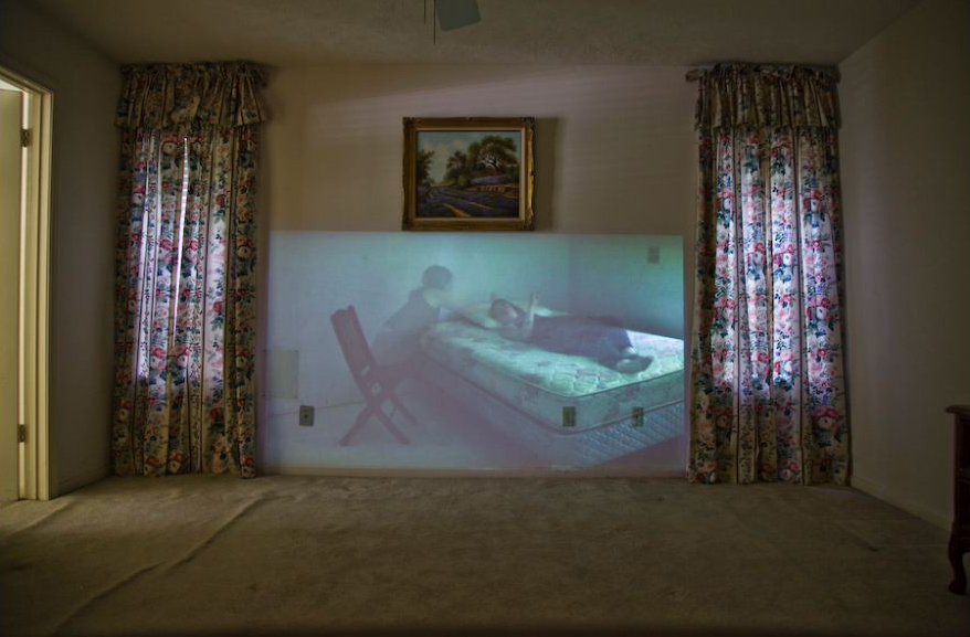 "Carrie Marie Schneider, care, 2012. Still from HD video, 5:13 minutes. Installation view: ""Care House,"" 2012."