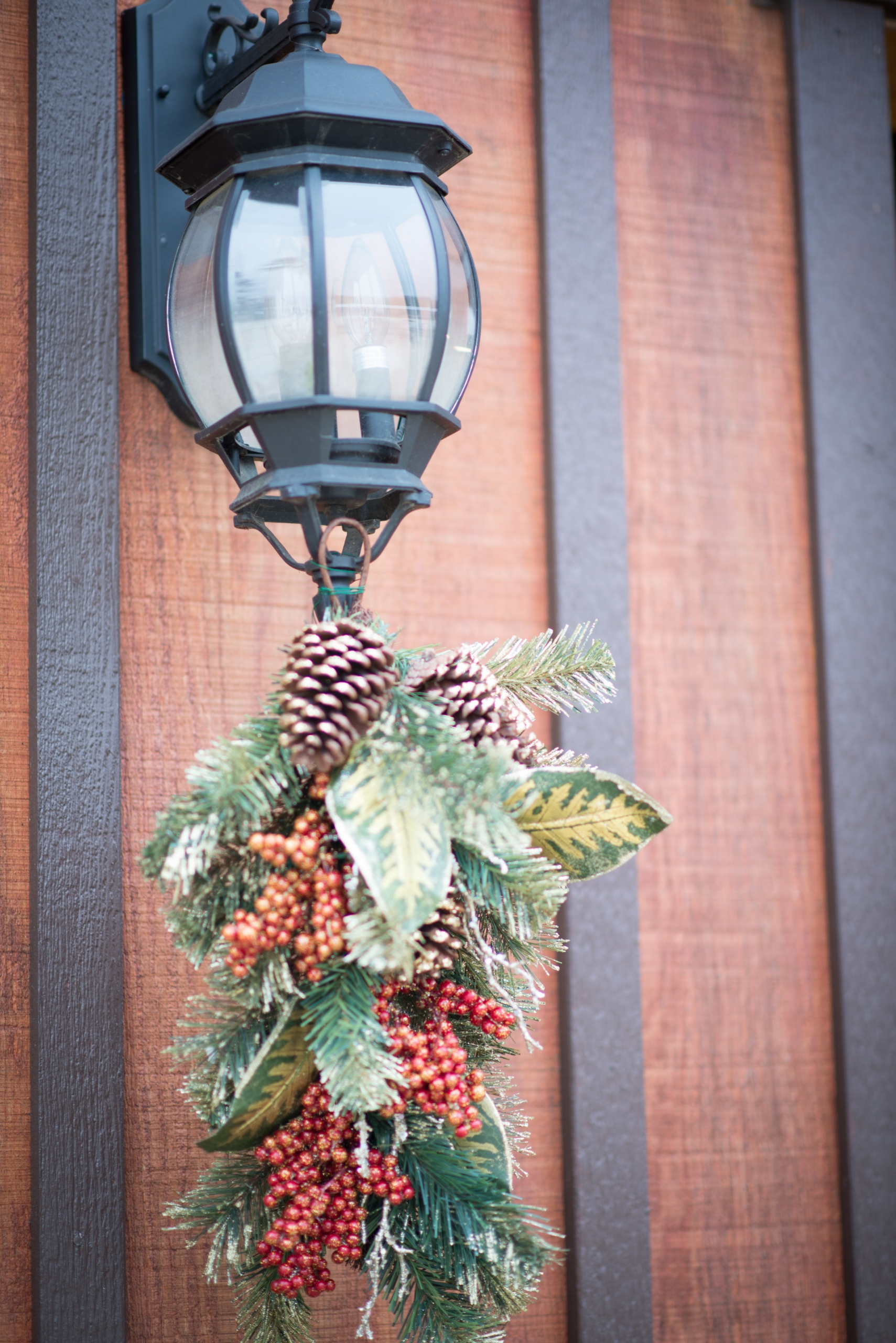 Winter pine cone decorations hang on a lantern for the Christmas show