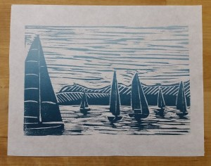 print in ombre blue and white of sailboats on water