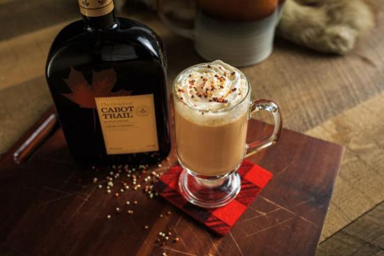 cabot trail maple liqueur in a glass with whipped cream