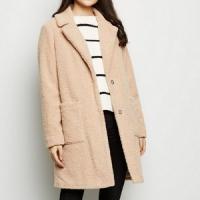 Manteau nude longueur XL à effet peau de lainée