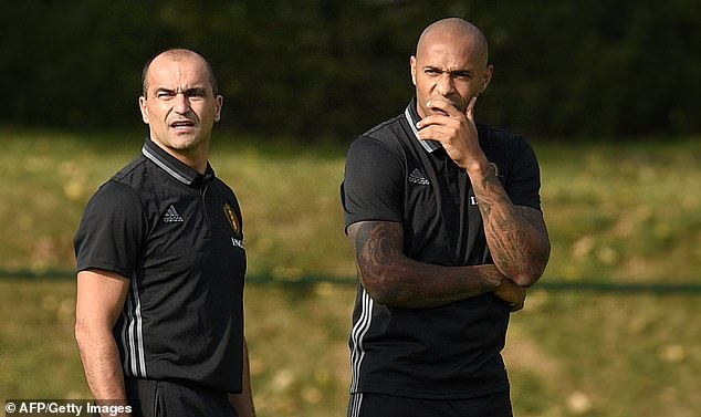 After leaving Arsenal, Henry became an assistant to Roberto Martinez (left) at Belgium in 2016