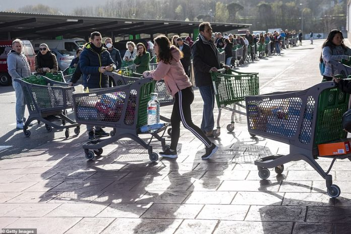 Queues of trolleys wait to be allowed into a supermarket on March 14 inIrun near San Sebastian after the Spanish government declared a state of emergency one day earlier