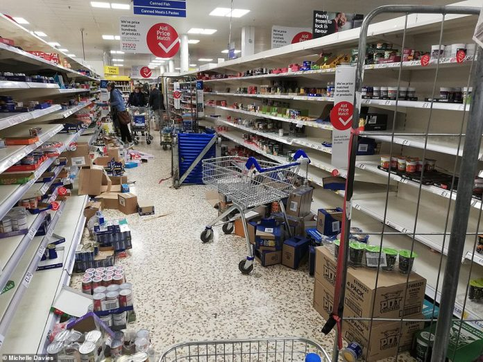 Coronavirus panic-buying unleashed carnage on British supermarkets on March 14, 2020, as hoards of shoppers gutted the nation's food and toilet roll aisles (Tesco in Colney Hatch, London, pictured)