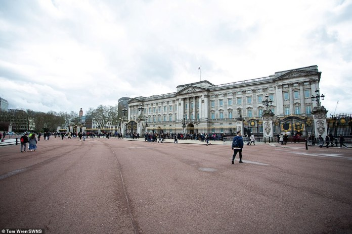 Britain's once busy and bustling streets resembled ghost towns on March 14 as businesses started to announce closure dates amid the spread of coronavirus (pictured, Buckingham Palace)