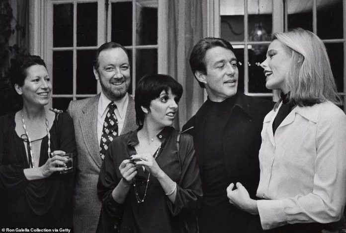 Of Peretti's designs, Liza Minnelli told Vanity Fair in 2014: 'Everything was so sensual, so sexy. I just loved it. It was different from anything I'd ever seen'. Pictured left to right:Elsa Perretti, Jack Haley Jr., Liza Minnelli, Halston and Margaux Hemingway