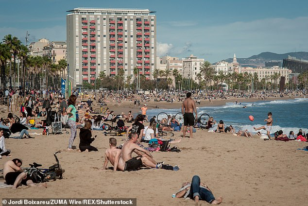 November: Spanish beaches are typically crammed with tourists soaking up the sun (Barcelona pictured)