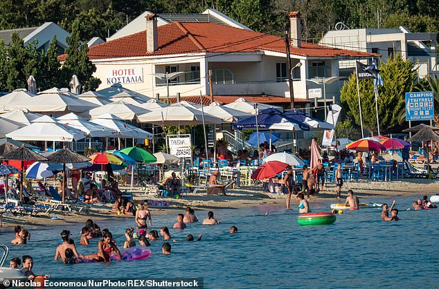 Popular islands Mykonos, Santorini, Corfu and Crete are already booking up fast, with most bookings from 2020 rolled over into this year. Pictured, holidaymakersin Chalkidiki in Northern Greece last summer