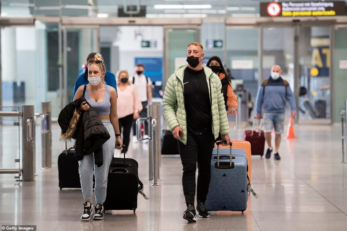 Passengers arrive at Malaga Airport this morning on a flight from London as they walk through the arrivals area