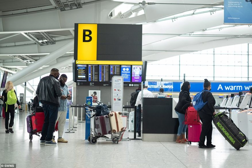 Travellers at Heathrow Terminal 5 said any change in the rules 'won't stop us going on holiday' as they prepared to jet to the Mediterranean. Pictured: Heathrow today