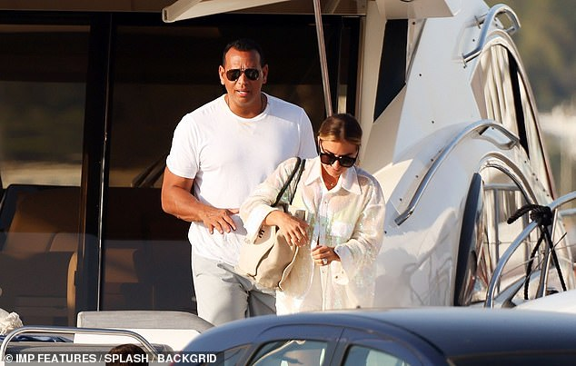 Accessorized: She carried a cream-colored tote bag and wore thick black sunglasses