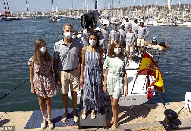 King Felipe, 53, kept it casual with a pale grey polo shirt and a pair of beige shorts, with slip-on open toe shoes