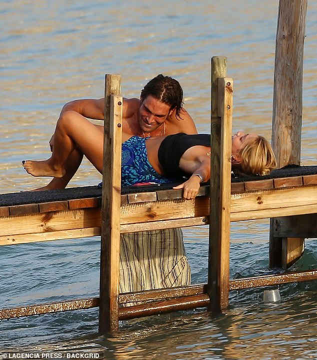 Good times: Jon looked like he was about to pull her in the water