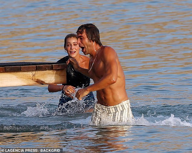 Summer fun:Eventually though Jon and Alessandra got into the water for a dip, despite the star wearing a crop top and trousers