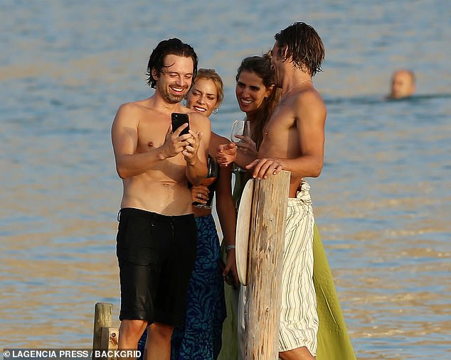 Smiling: Sebastian showed off his pearly white teeth