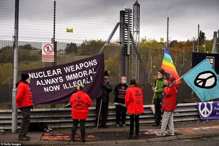 Anti-nuclear campaigners hold banners and placards outside Her Majesty's Naval Base, Clyde, on October 25, 2020 in Faslane