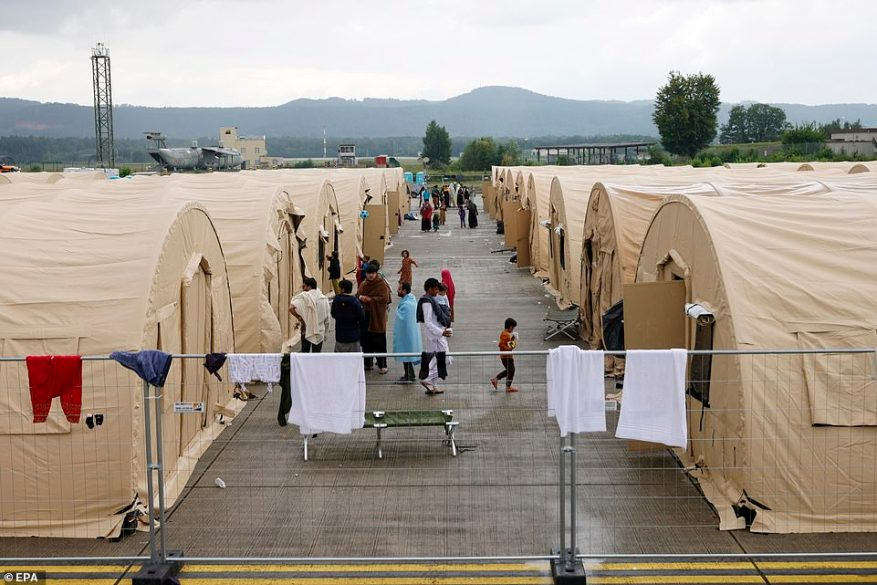 Afghan evacuees are pictured on August 30 at Ramstein Air Base in Germany. Under the U.S. agreement with Germany, evacuees can remain on the base for no longer than 10 days