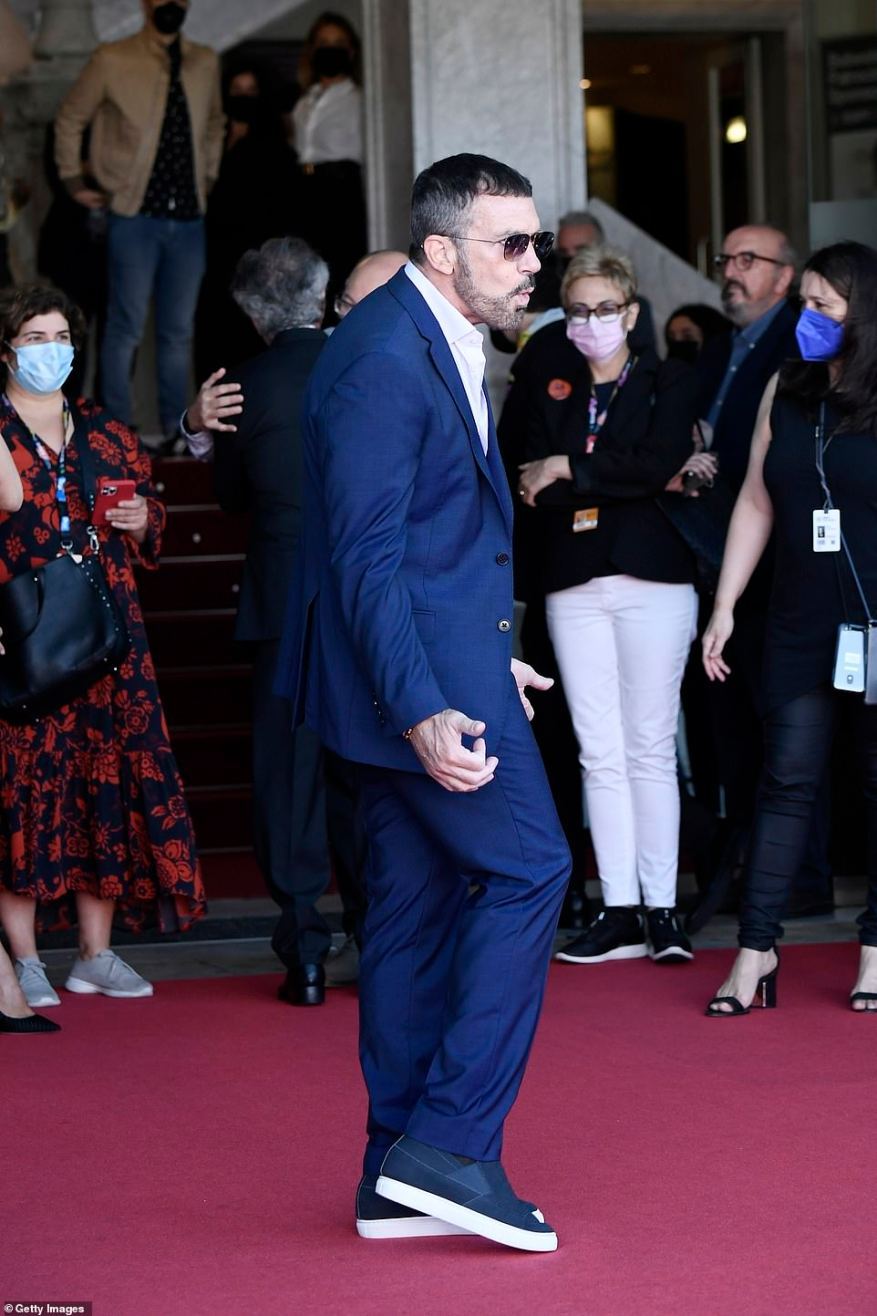 Good spirits: The actor put on an animated display as he headed into the event