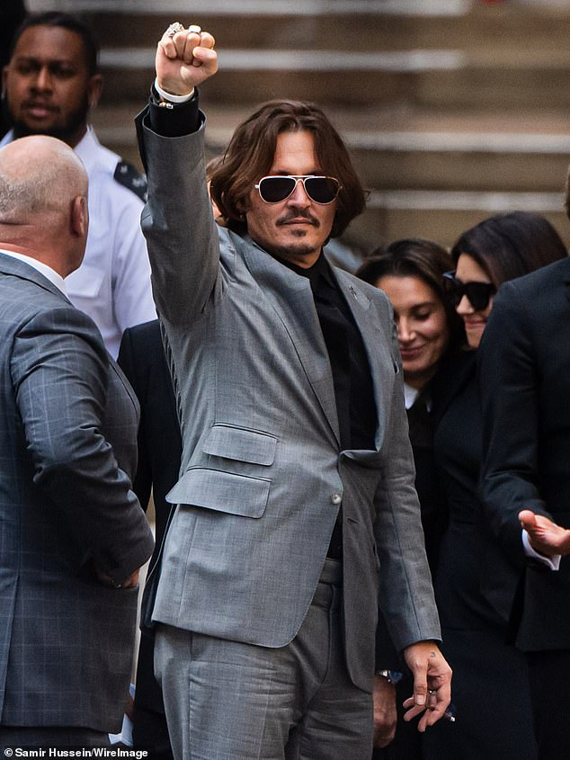 Depp is pictured on July 29, 2020, outside the High Court in London during the case
