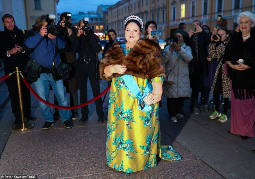Ready to party! The Grand Duchess cut a striking figure in a green and blue gown, accessorizing with a fur stole, a glittering tiara and a sparkling clutch bag.