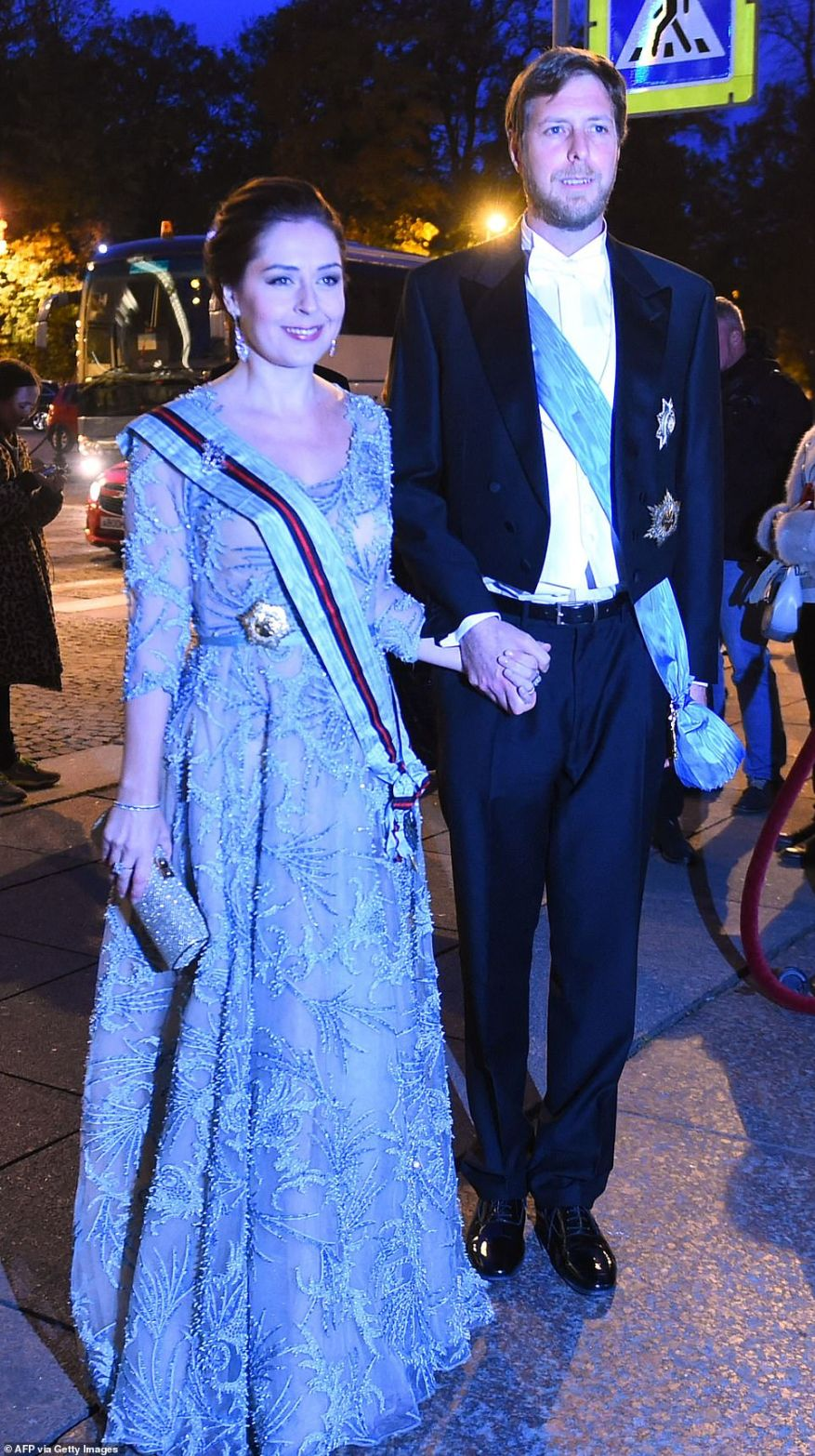 Albania's pretender to the throne, Crown Prince Leka Zogu II, the grandson of self-proclaimed King Zog and his wife Elia Zaharia arrive to attend the evening gala dinner