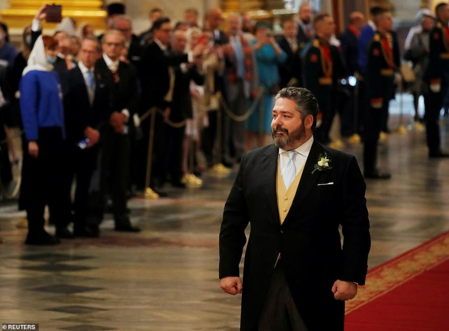 Grand Duke George Mikhailovich Romanov could be seen smiling as he arrived for his wedding ceremony to Victoria Romanovna Bettarini at St. Isaac's Cathedral.