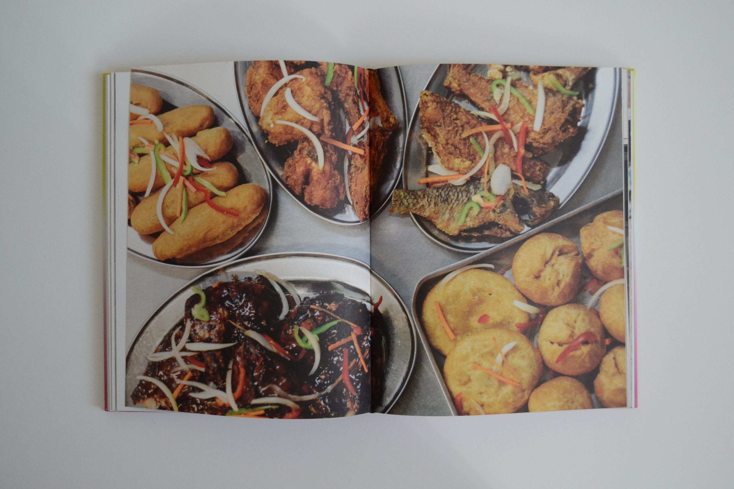 Double page spread featuring food from Peppers 'n' Spice restaurant