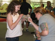 Volunteer Anna with a visitor to Beechwood Fair Day Adoption Event