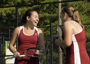Tennis-doubles-partners-laughing
