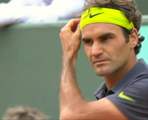 Roger Federer fixing smoothing hair yellow headband hands Goffin match pictures images photos screencaps French Open 2012