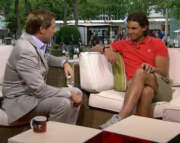 Rafael Rafa Nadal Tennis Channel interview red Nike polo crossed legs khaki shorts tennis shoes tan pictures photos images screencaps