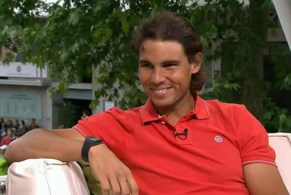 Rafael Nadal Nike red polo Tennis Channel interview grin tan line photos pictures screencaps