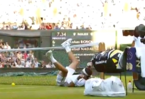 Rafa fall Rosol match net legs back fell down pictures photos Wimbledon 2012