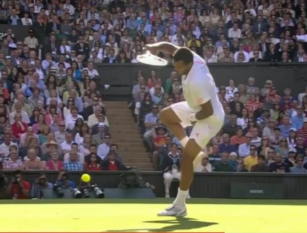 Jo Wilfried Tsonga grabs himself nuts balls family jewels privates hit Andy Murray photos pictures images screencaps Wimbledon 2012