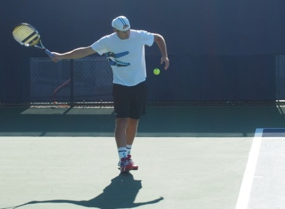 Andy Roddick forehand swing tennis ball Lacoste crocodile shirt striped hat practice courts photos pictures images