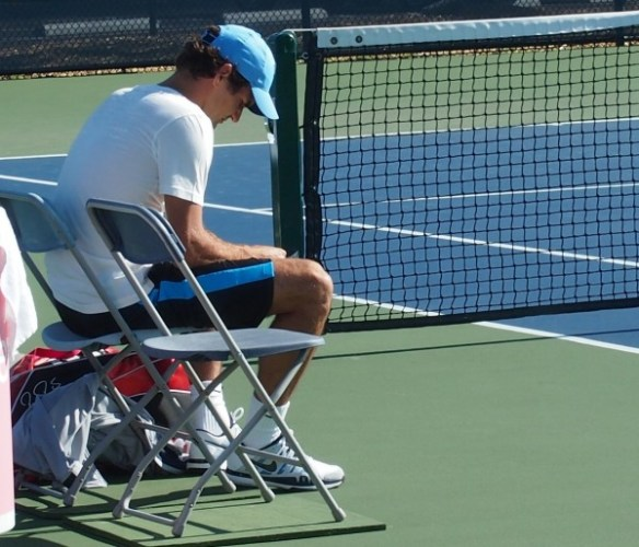 Roger Federer contemplative serene thinking sitting chairs practice Cincinnati Western and Southern Open 2012