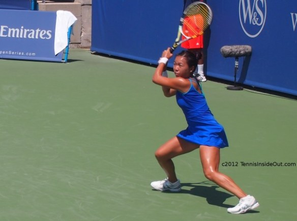 Vania King Western and Southern Open Cincinnati racquet swing forehand stretch blue dress pictures photos