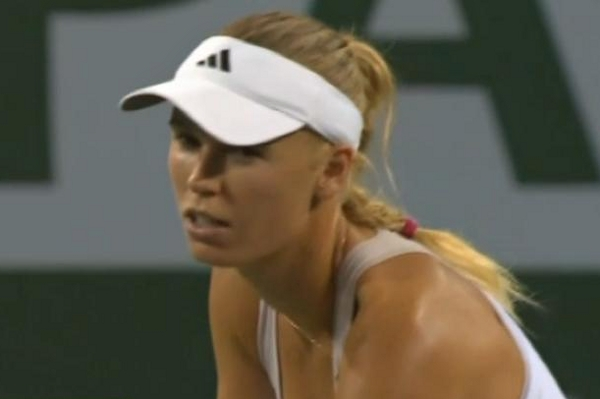 Caroline Wozniacki squinting Clint white visor dress Indian Wells blonde braid pictures photos images screencaps