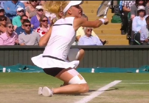 Aga Radwanska kneel down crouching shot taped thighs skirt flying up action shot Wimbledon pictures