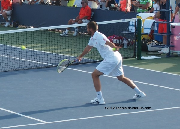 Mikhail Youzhny warm up volley doubles match Western and Southern Open